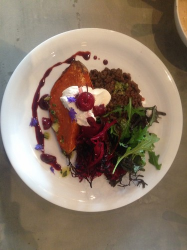 baked sweet potato with red wine miso lentils, sour cream, seaweed and beetroot salad and a pickled cherry