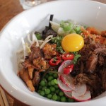 Rice'n'Stuff - japanese sticky rice bowl with tamari pork, buttered chanterelles, miso aubergine, kimchi, taberu rayu and peas + a raw Nurney Farm egg yolk
