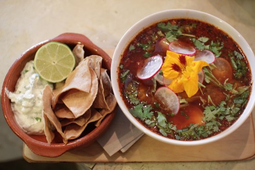 Mexican Pozole - Cascabel and guajillo broth with shredded pork belly, hominy corn, coriander cream and lime tortillas